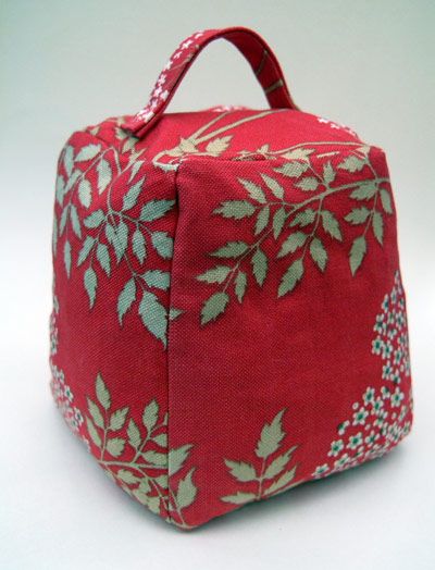 red fabric door stop