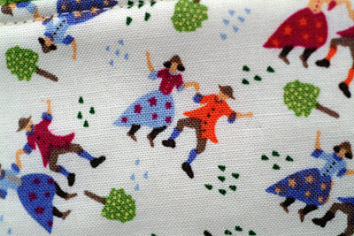 dancing couple detail on make-up bag