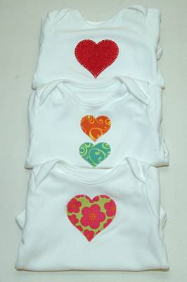 fabric hearts appliquéd onto baby vests